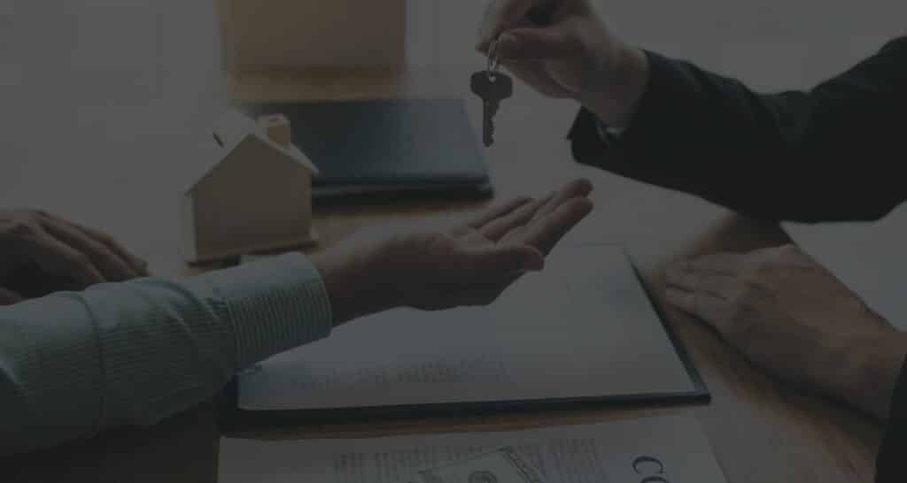 lawyer handing over key for rental property